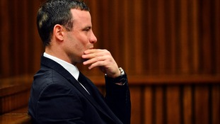 Oscar Pistorius listens to his doctor give evidence at his murder trial.