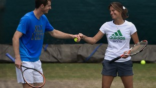 Andy Murray  fist bumps his cooach Amelie Mauresmo during a training session ahead of the game.