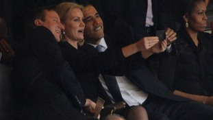 Many hands...David Cameron, Helle Thorning-Schmidt and President Obama famously took a group selfie during Nelson Mandela's memorial