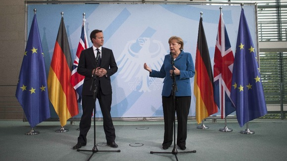 German Chancellor Angela Merkel and David Cameron discuss the Eurozone in Berlin on Thursday.
