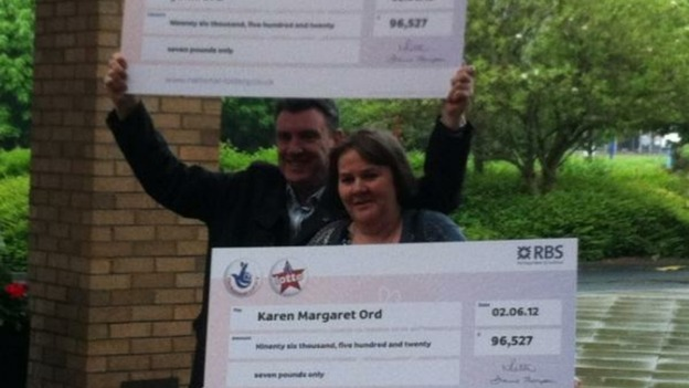 John and Karen Ord with their identical cheques