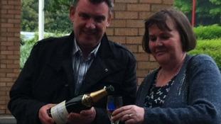 John and Karen Ord Popping the Champagne