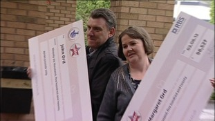 The winners with their cheques