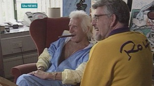Jimmy Savile poses with Rolf Harris at the ITV West studios in 1992.