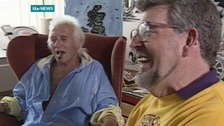 Jimmy Savile and Rolf Harris share a joke during filming at ITV West studios in 1992.