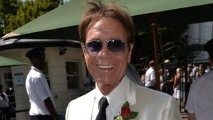Praying for rain? Sir Cliff Richard observed the formal dress code requirements at Wimbledon.