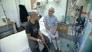 Louis and Mike Powis on hospital bed