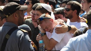 Friends and relatives mourn during the memorial service to Gil-Ad Shaer,16.