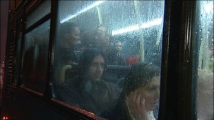 Soaked fans on the bus