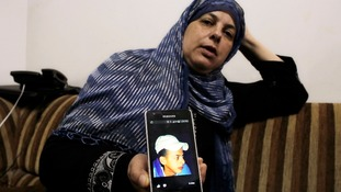 Suha, mother of murdered Palestinian teen Mohammed Abu Khudair, shows a picture of her son.
