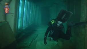 A diver explores the corridors of the wrecked luxury cruise liner, which sank ff the coast of Isola del Giglio in Italy in 2012.