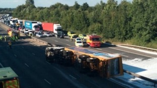 The overturned lorry on the M11 in Essex which spilled acid over both carriageways.