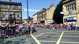 Crowds gather in Otley, one of the Yorkshire towns on the route.