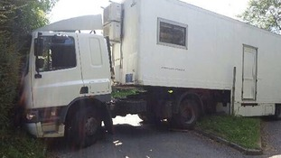 A lorry driver got his truck stuck down a narrow country lane after following his sat nav, said police.