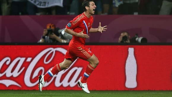 Alan Dzagoev enjoys scoring Russia&#x27;s first.