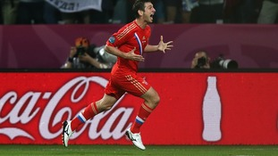 Alan Dzagoev enjoys scoring Russia's first.