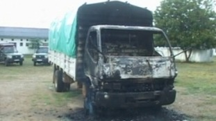 A truck burnt out in one of the raids in Kenya on Saturday night, when at least 29 people were killed.