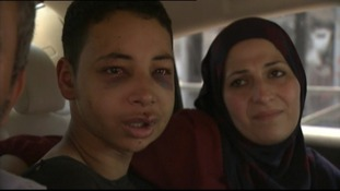 Tariq Abu Khdeir, pictured with his parents after his release today.