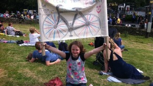 Eyde Clayton, 10, with her handmade welcome to Yorkshire sign