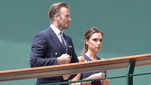 David and Victoria Beckham make their way to the match.