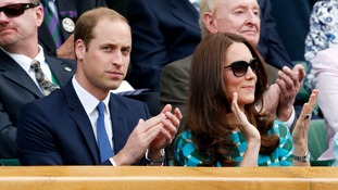 Prince William and the Duchess of Cambridge watch the match.