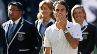 Roger Federer blows a kiss to the crowds after his defeat by Novak Djokovic.