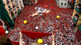 Thousands of revellers cram into the main square in northern Pamplona for the start of the running of the bulls festival.