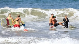 The moment Steven Robles was pulled out of the water by surfers after being attacked by a great white in LA.