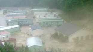 Scene at Welsh caravan parks after severe flooding.