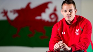 Badminton player Nick Strang models Wales' colours.