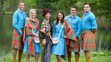 Members of the Scottish team posing with designer Jilli Blackwood (centre).