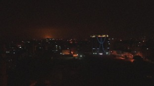 The sky lights up over Gaza as the airstrikes hit.