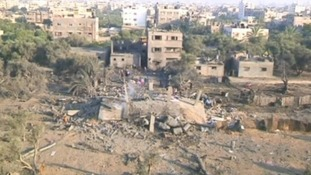 The aftermath of the Israeli airstrike on the Gaza Strip this morning shows buildings destroyed in the attack.