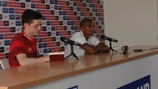 Ashley Young addresses the media in Krakow.