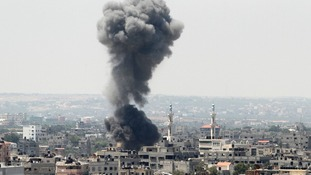 Smoke rises following an Israeli air strike in Gaza City.