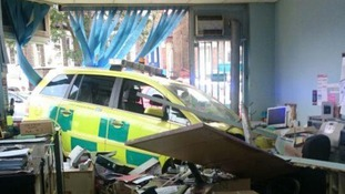 Insurance office wrecked as ambulance ploughs through the window