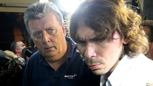 Ray Whelan, left, being arrested in Brazil on Monday.