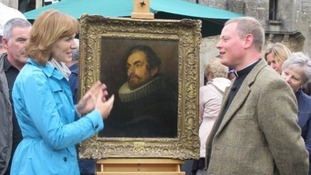 Father Jamie MacLeod with the van Dyck, portrait bought for £400, with Antiques Roadshow host Fiona Bruce.