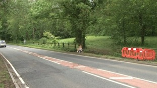Police close the road where the crash happened that left three dead and one critical