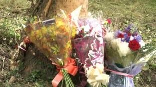Flowers have been placed at the scene of the crash
