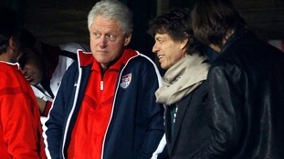 Jagger and Clinton watch the 2010 World Cup second round match.