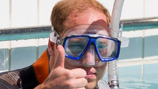Prince William dons mask, wetsuit and fins to go diving