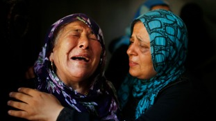 Palestinian relatives mourn during a funeral in the town of Beit Hanoun in the northern Gaza Strip.