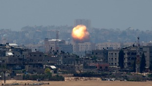 An explosion is seen after an air strike in northern Gaza today.