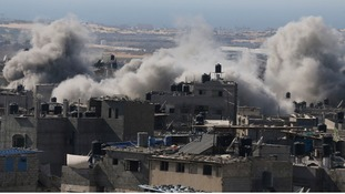 Smoke is seen following what police said was an Israeli air strike in Rafah in the southern Gaza Strip today.