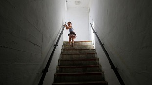 A girl leaves a bomb shelter after a siren warning of incoming rockets was sounded in the southern city of Ashkelon, Israel, today.