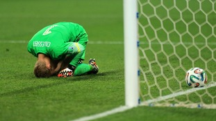 Netherland goalkeeper Jasper Cillessen falls to his knees as he fails to save a single penalty during the shootout.