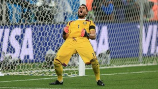 Argentina's goalkeeper Sergio Romero celebrates their victory.