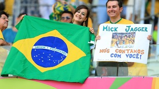 Brazil fans smile before the World Cup semi-final in which they lost 7-1 to Germany,