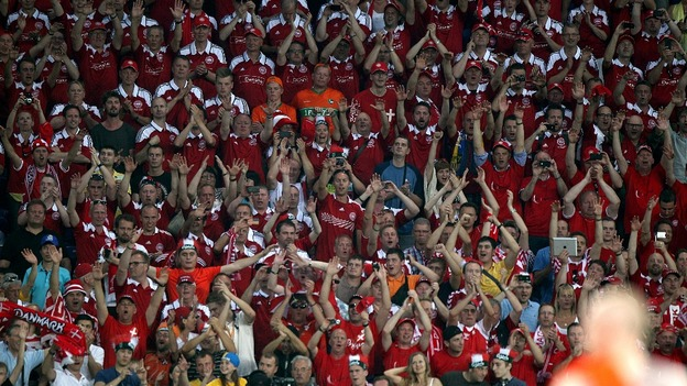 Denmark fans celebrate their win over Holland.